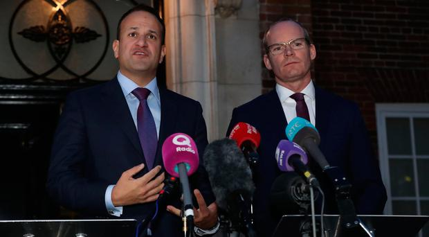 Taoiseach Leo Varadkar (left) and Irish Foreign Minister Simon Coveney speaking outside Stormont House in Belfast. Pic: Niall Carson/PA Wire