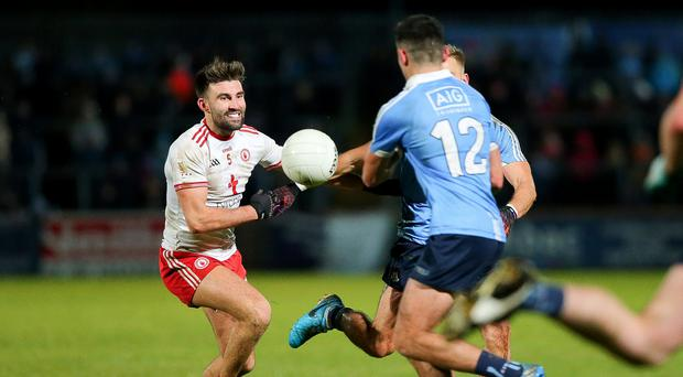 Growing fears: Tyrone ace Tiernan McCann picked up an injury in the win over Kildare