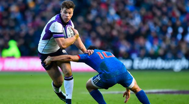 Moving forward: Huw Jones uses his speed against France