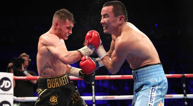 Rising up: Belfast ace Ryan Burnett takes care of Zhanat Zhakiyanov in October