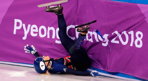 In a spin: Great Britain's Elise Christie slides into the barriers after making contact with a rival in the 500m short track final