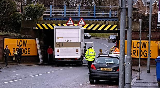A lorry has become stuck under a railway bridge in County Antrim. It happened on Wednesday afternoon on Antrim Street in Lisburn causing serious traffic disruption in the area over lunchtime on Wednesday. Photo Graham Watt/Pacemaker Press