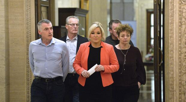 Michelle O'Neill and the Sinn Fein talks team. Pic: Stephen Hamilton