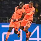 Smiles better: Sadio Mane (left) celebrates the first goal of his hat-trick for Liverpool last night with Georginio Wijnaldum