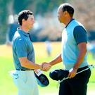 Shake on it: Rory McIlroy and Tiger Woods at the end of their round in the Genesis Open