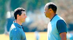 Shake on it: Rory McIlroy and Tiger Woods at the end of their round in the Genesis Open earlier this year.