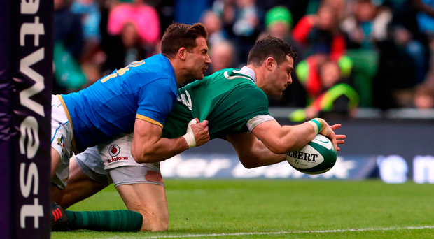 Pain game: Robbie Henshaw is on the sidelines after suffering injury scoring this try against Italy