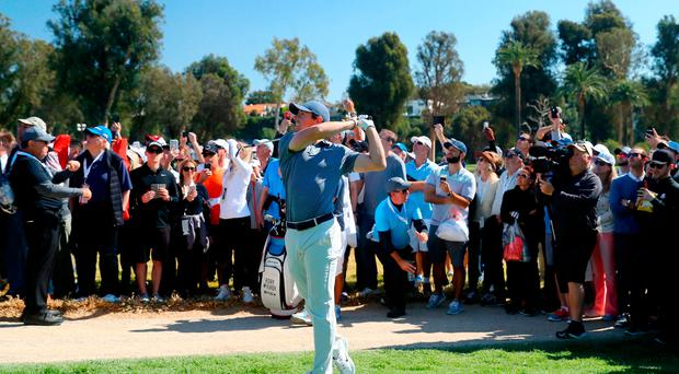 Tough work: Rory McIlroy had an up-and-down day