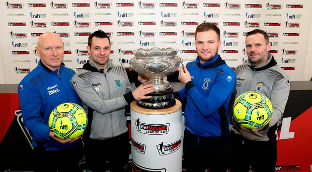 Prize guys: Ballymena United assistant Bryan McLoughlin and skipper Jim Ervin, Dungannon Swifts captain Ryan Harpur and boss Rodney McAree get a look at the League Cup