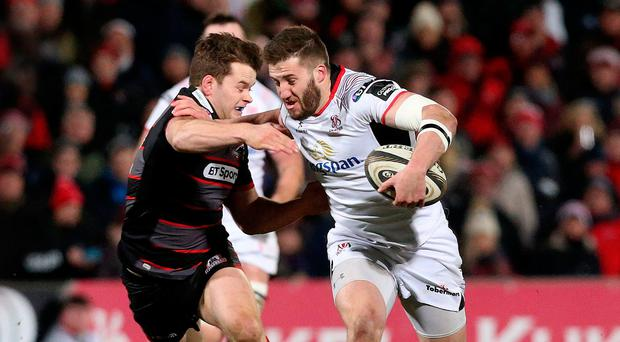 Pitch battle: Ulster ace Stuart McCloskey on a charge