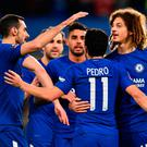 Blue heaven: Pedro celebrates with team mates after scoring Chelsea's second goal against Hull at Stamford Bridge last night