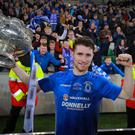 Man of the Match Ryan Mayse celebrates League Cup success with the Dungannon players. (Photo by Kevin Scott / Belfast Telegraph)