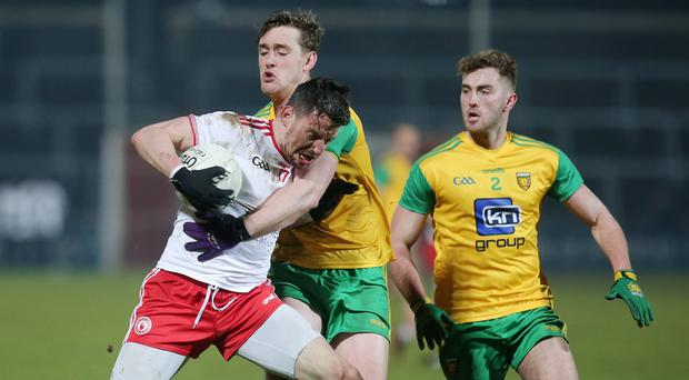 Bank of Ireland Dr. McKenna Cup Final, Athletic Grounds, Armagh 17/2/2018 Donegal vs Tyrone Donegal's Hugh McFadden with Tyrone's Matthew Donnelly ©INPHO/Jonathan Porter