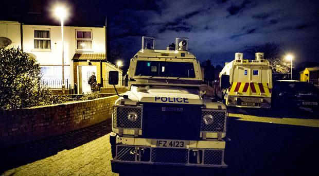 Police investigating the murder of Raymond Johnston search a property in the Colinmill area of west Belfast on February 17th 2018 (Photo by Kevin Scott / Belfast Telegraph)