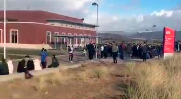 Swansea University Bay Campus is evacuated after the earthquake. PA