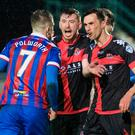 Potent Bru: Crues players Billy Joe Burns (centre) and Declan Caddell confront Inverness rival Liam Polworth over a penalty award