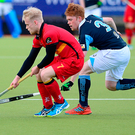 Pressure on: Lisnagarvey's Ryan Getty clashes with Banbridge's Peter Brown