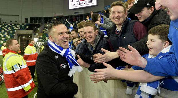 Rodney McAree leads celebrations with Dungannon supporters after the club's League Cup success.