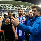 William Grigg of Wigan Athletic with fans on the pitch after the Emirates FA Cup Fifth Round match between Wigan Athletic and Manchester City