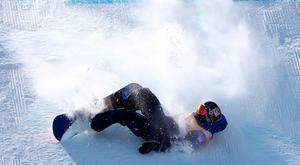 Hard landing: Aimee Fuller crashes during the snowboard big air event