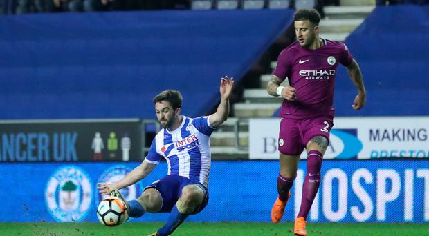Decisive say: Will Grigg fires home the winner for Wigan against Man City in the fifth round of the FA Cup