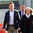 Ulster and Ireland rugby player Paddy Jackson arrives at Laganside Magistrates court this morning. / Credit: Pacemaker