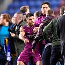 Ugly scenes: Sergio Aguero claims a Wigan fan spat at him