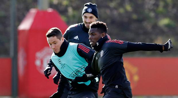 Shaping up: Paul Pogba trains in Spain yesterday after a recent illness