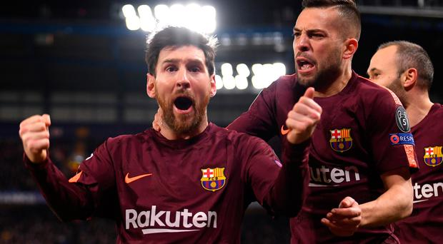 Finely poised: Lionel Messi roars with delight after hitting Barca's equaliser at Stamford Bridge