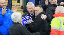 Family affair: Dungannon boss Rodney McAree celebrates with dad Joe and mum Carol on Saturday