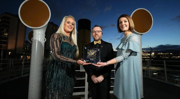 The search to find Northern Ireland's top hospitality hot spots came to a dramatic conclusion as the Top 100 Hospitality Businesses were revealed. Mark Stewart, Chair of Hospitality Ulster is pictured with winners Laura Keegan from Keegans Bar Armagh, left, and Lou Mathers from Newforge House, Magheralin. Photo by Kelvin Boyes / Press Eye.