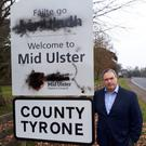 Sinn Fein MLA Colm Gildernew has condemned vandalism to an Irish language road sign