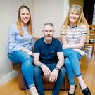 Family man: John Connolly at home in Newry with his partner Suzanne (left) and daughter Shelby