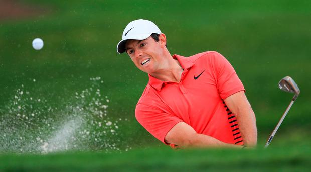 Green for go: Rory McIlroy at the third in last night's first round of the Honda Classic in Florida