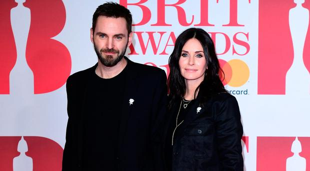 Courteney Cox and Johnny McDaid attending the Brit Awards at the O2 Arena, London (Ian West/PA Wire)