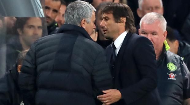 Jose Mourinho, left, and Antonio Conte have engaged in a public war of words (John Walton/PA)