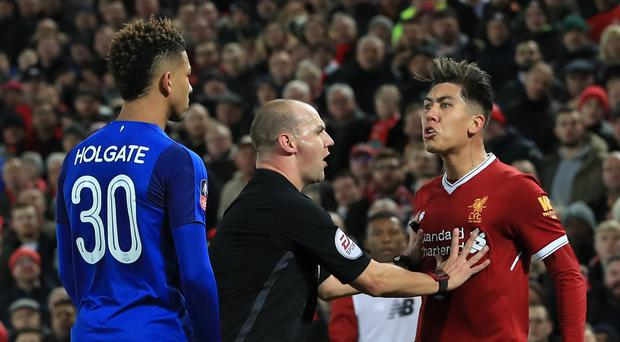 Roberto Firmino (right) was cleared of racially abusing Mason Holgate (left)