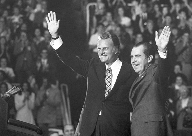 FILE - In this Oct. 16, 1971 file photo, Evangelist Billy Graham and President Nixon wave to a crowd of 12,500 at ceremonies honoring Graham at Charlotte, N.C.