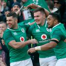 Ireland's wing Jacob Stockdale (C) celebrates with Ireland's full-back Rob Kearney (L) and Ireland's centre Bundee Aki (R) after scoring Ireland's first try