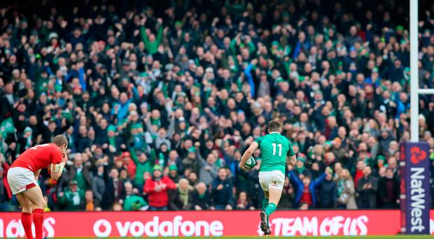 Ireland's wing Jacob Stockdale runs in their late try during the Six Nations international rugby union match between Ireland and Wales at the Aviva Stadium in Dublin, on February 24, 2018. Ireland won the game 37-27. / AFP PHOTO / Paul FAITHPAUL FAITH/AFP/Getty Images