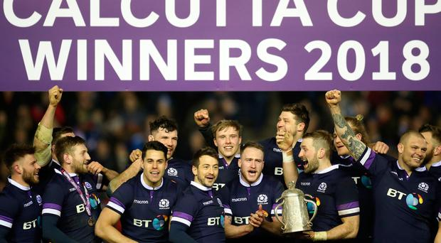 Scotland players celebrate with the Calcutta Cup during the RBS Six Nations match at BT Murrayfield, Edinburgh. Pic: PA