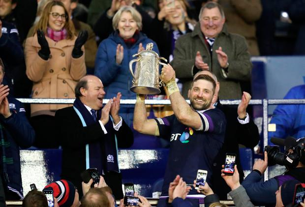 Scotland Captain John Barclay celebrates with the Calcutta Cup trophy during the RBS Six Nations match at BT Murrayfield, Edinburgh. PRESS ASSOCIATION Photo. Picture date: Saturday February 24, 2018. See PA story RUGBYU Scotland. Photo credit should read: Jane Barlow/PA Wire. RESTRICTIONS: Editorial use only, No commercial use without prior permission