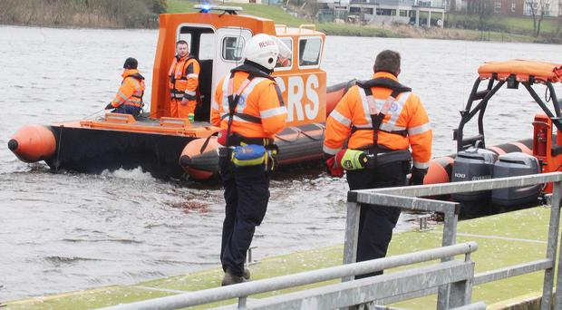 Members of The Community Rescue on The River Bann in Coleraine on Saturday afternoon looking for a missing Coleraine woman. Pic: Mark Jamieson