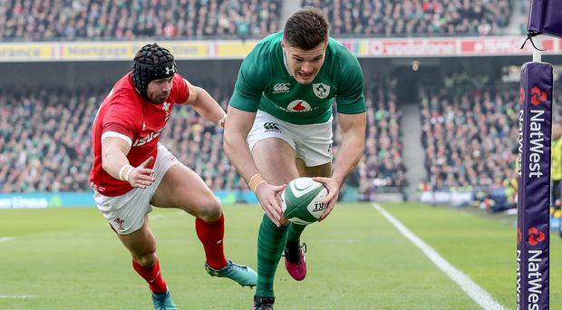 Touch down: Ireland's Jacob Stockdale scores Ireland's first try despite the attention of Leigh Halfpenny