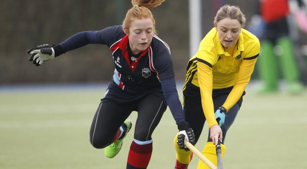 My ball: Belfast Harlequins' Zoe Wilson (left) and Emily Beattie of Pembroke Wanderers