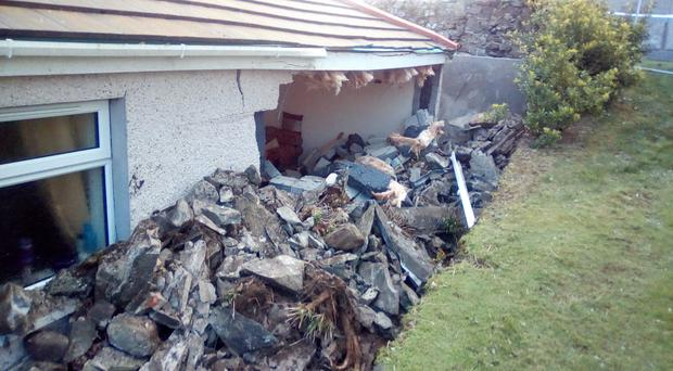 The damage caused to the McCartans' home by the collapsed church wall