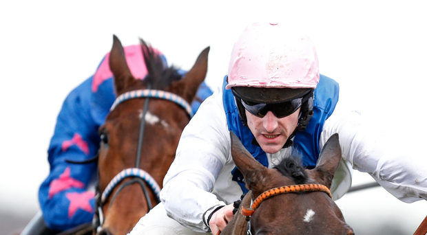 Leading duo: Brian Hughes rides Waiting Patiently to victory in the Grade 1 Ascot Chase
