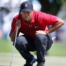 Lofty ambitions: Tiger Woods says he can feel improvements