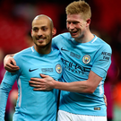 Cup of joy: David Silva and Kevin de Bruyne celebrate City's Wembley success