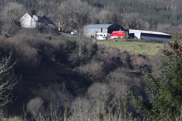 Emergency services at the house in Derrylin, Fermanagh (Brian Lawless/PA)